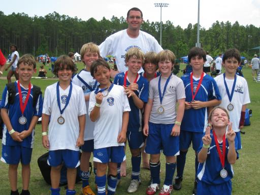 Matthew with his tournament-winning soccer team
