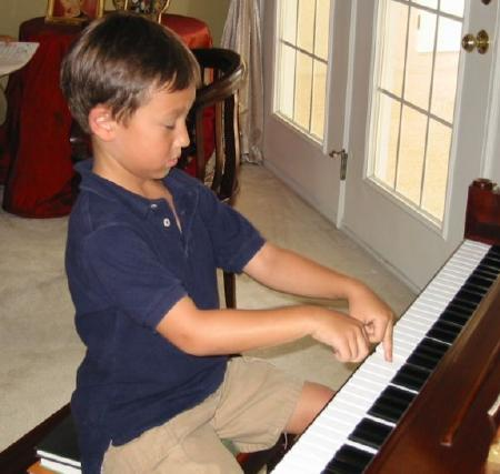 Practicing piano for his 'book one' party