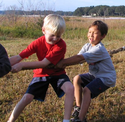 Matthew at Camp Imokolee playing tug-of-war with his buddy Cole