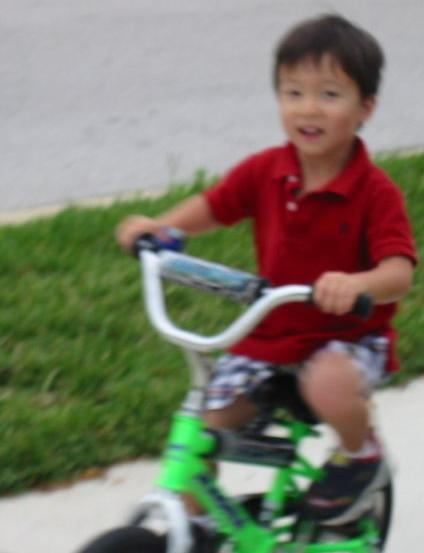 Ryan riding his bike for Bubbe and Papa without training wheels