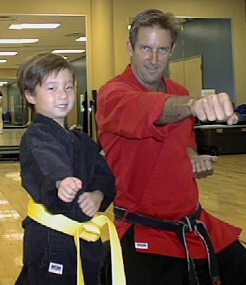 Ryan showing Mr. Davin (his karate instructor) some key moves