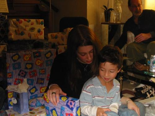 Ryan with Rachel opening gifts